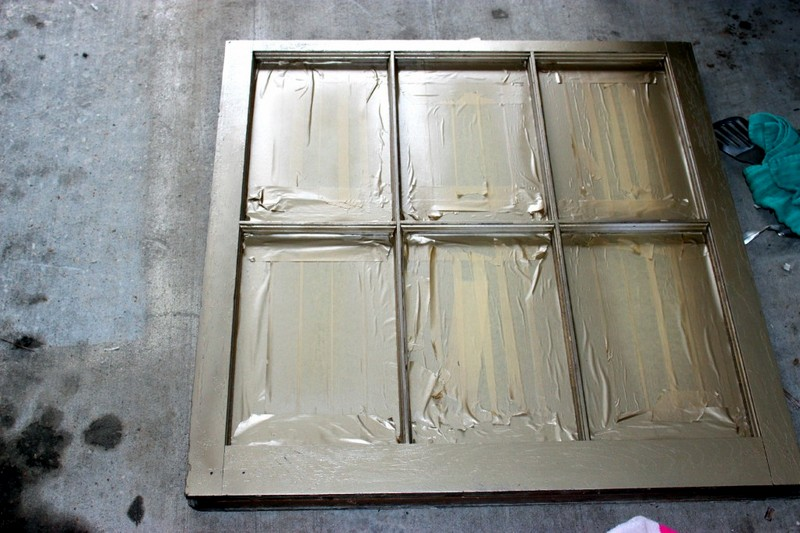 spray painting an old window to create a decorative mirror   Satisfaction Through Christ